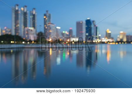 City blurred bokeh light with water reflection abstract background