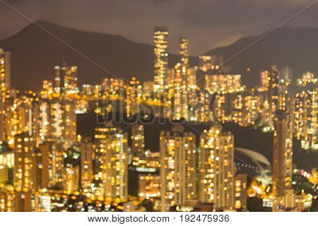 Hong Kong city apartment blurred bokeh light on high hill abstract background