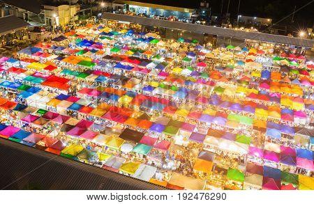 Night view multiple colour flea market cityscape downtown background