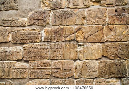 Hieroglyphics on old a stone block wall