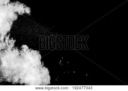 abstract white powder explosion on black background.