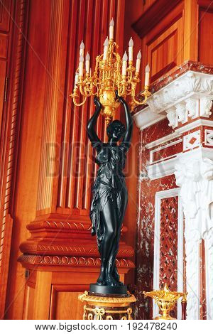 beautiful table lamp in the form of a statue in a posh house