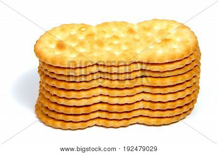 Salted cracker isolated on over white background
