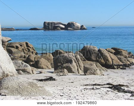 CLIFTON,CAPE TOWN, SOUTH AFRICA, WITH HUGE BOULDERS IN THE FORE GROUND AND BACK GROUND 33lijh