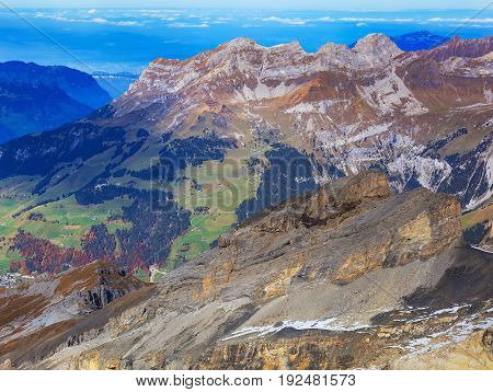 View from Mt. Titlis in the Swiss Alps in autumn. The Titlis is a mountain located on the border between the Swiss cantons of Obwalden and Bern, mainly accessed from the town of Engelberg.