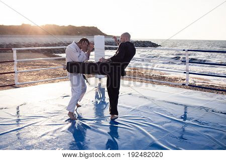 karate training on the outdoor boxing ring