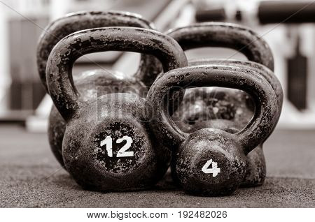 Kettle bell. Five old and rusty Kettlebells on the floor