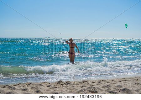 Happiness Attractive Girl In The Sea Splashing Water On Beach