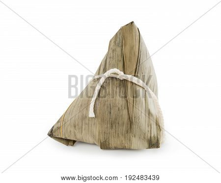 Chinese rice dumpling (Zongzi) wrapped with bamboo leaves and stuffed with peanuts mushroom sweet mashed taro and salted egg yolk isolated on white background (clipping path included)