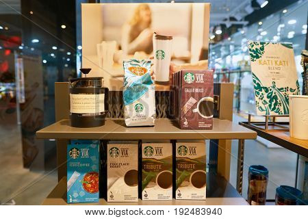 SEOUL, SOUTH KOREA - CIRCA MAY, 2017: goods on display at Starbucks coffee shop in Seoul. Starbucks Corporation is an American coffee company and coffeehouse chain.