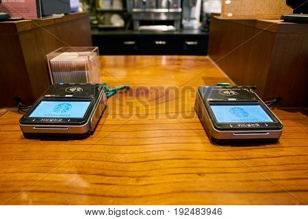 SEOUL, SOUTH KOREA - CIRCA MAY, 2017: payment terminals at Starbucks coffee shop in Seoul. Starbucks Corporation is an American coffee company and coffeehouse chain.