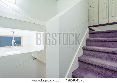Modern Interior. View of stairs, and second story area.
