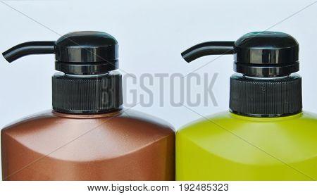 shampoo bottle pump head press on white background