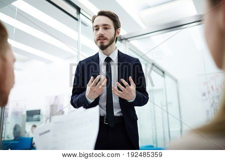 Businessman explaining his viewpoint to co-workers
