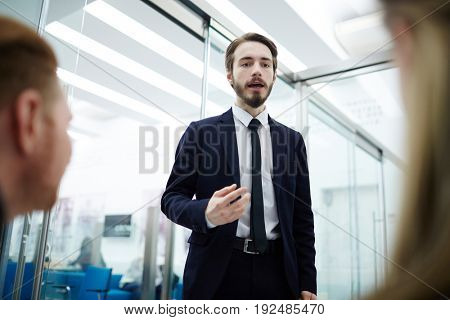 Confident ceo motivating his employees at meeting