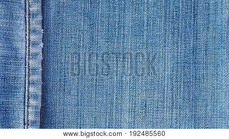 Denim jeans texture, denim jeans background with seam for beauty, fashion and clothing concept design.