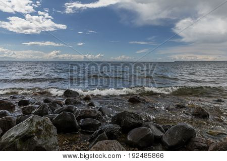 The big Mille Lacs Lake with shore rocks.