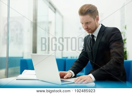 Businessman concentrating on networking at workplace