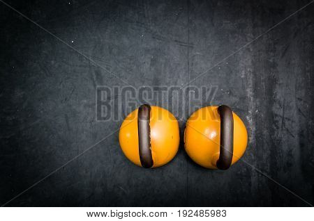 Kettle bells on the gym floor. Kettlebell sport.