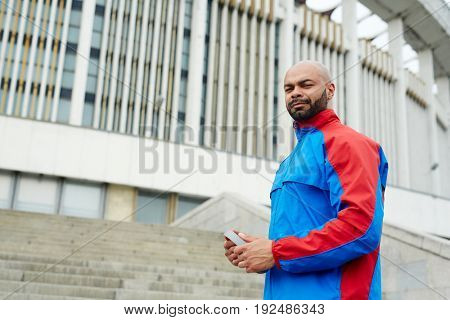 Sportsman with headphones and looking at camera