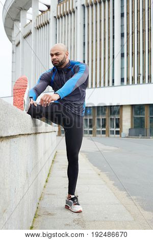 Healthy and active man making physical exercise outdoors