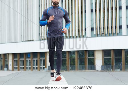 Young athlete practicing sportive walk in the city