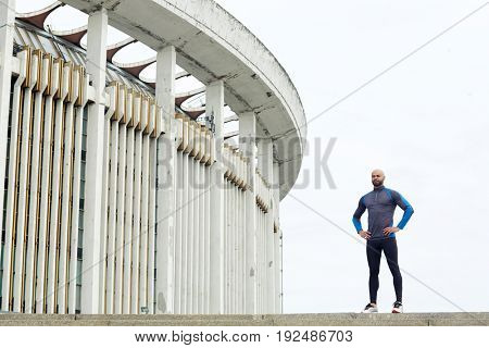 Sporty young man having training in urban environment