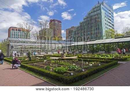 MOSCOW RUSSIA MAY 13 2017: Garden beds with medicinal plants and greenhouses in Aptekarsky Ogorod - the branch of the Botanical Garden of Moscow State University.