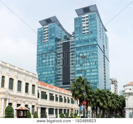 Urban modern architecture apartment office hotel blocks skyscraper into clouds sky