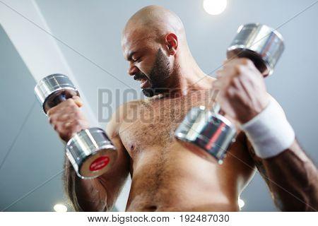 Sportsman making effort during exercise