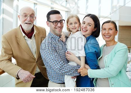Joyful family of five enjoying rest in hotel