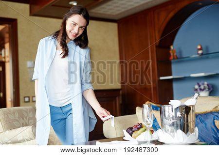 Pretty young woman in casualwear having rest in hotel