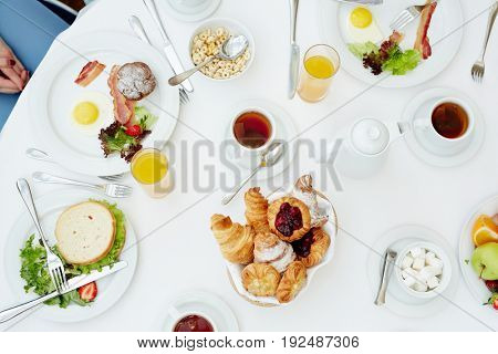 Served table with food and drinks for breakfast