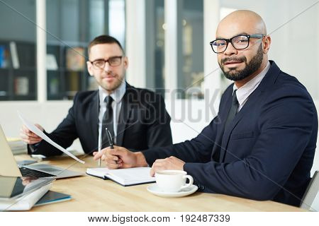 Young businessmen planning work and reading documents in office