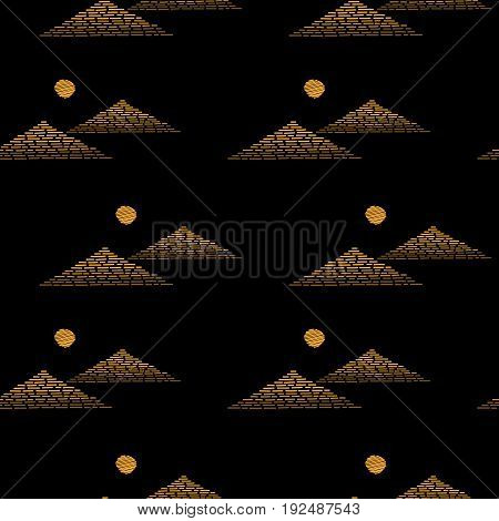 Seamless pattern with embroidery stitches imitation little gold pyramids and sun. Egyptian pyramids embroidery pattern for printing on fabric paper for scrapbook gift wrap.