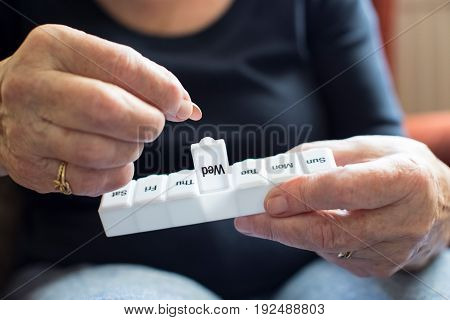 Senior Woman Taking Medication From Pill Box