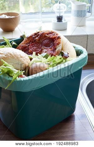 Fresh Food Waste In Recycling Bin At Home