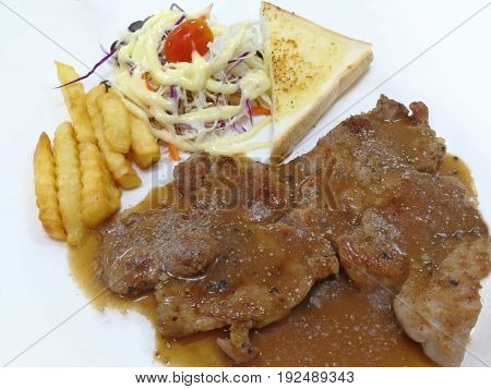 1 piece of fried meat with vegetables and salad on a white background plate