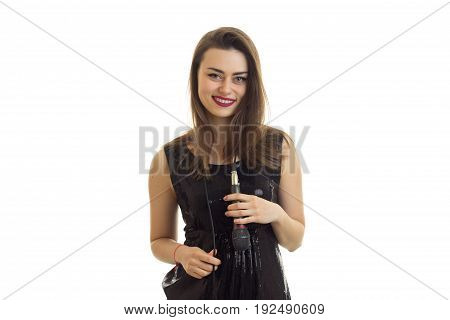 Beautiful woman in bright black dress smiling on camera with microphone on her neck isolated on white background