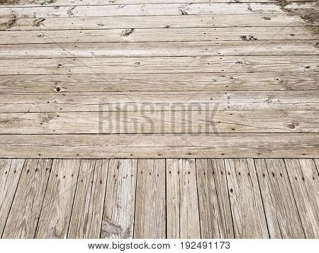 Weathered wood plank boardwalk for background or texture.