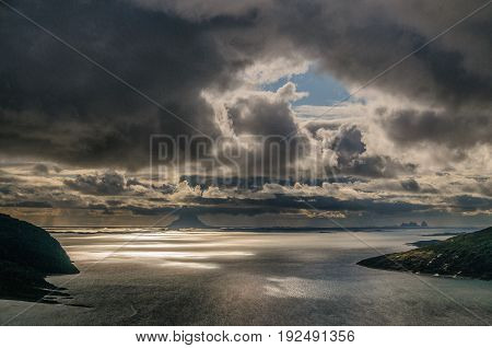 Sharp back-lit image of a Norwegian Fjord early evening.
