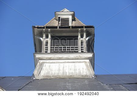 A ventilation tower on a roof of a build in Michigan
