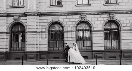 beautiful wedding couple walking around the city in Sunny weather at your wedding