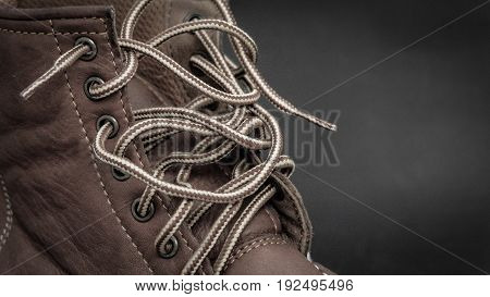 shoelace of brown leather shoes in studio