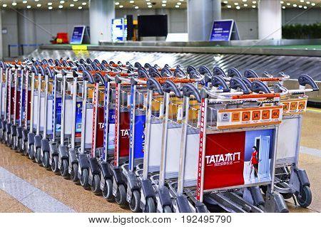 Beijing, China, June, 2017. Baggage Trolley Line Up at Beijing Capital Airport (PEK) Terminal 2, June 14 2017.