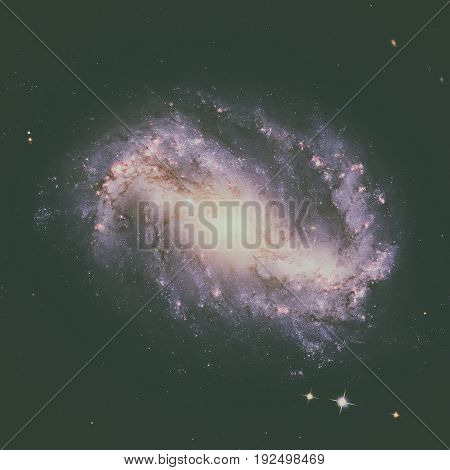 NGC 6217 is a barred spiral galaxy located some 67 million light years away, in the constellation Ursa Minor. Retouched image. Elements of this image furnished by NASA.