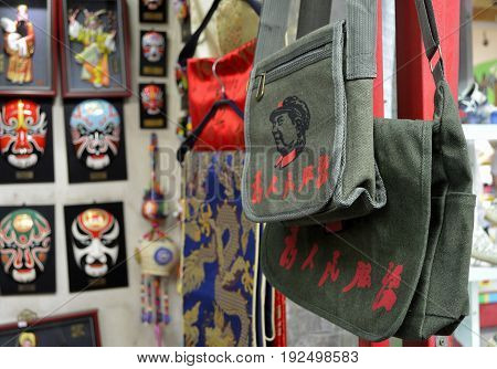 Beijing, China, August 17. A local shop is selling the green canvas bags with the print of Chairman Mao's head and his inscription