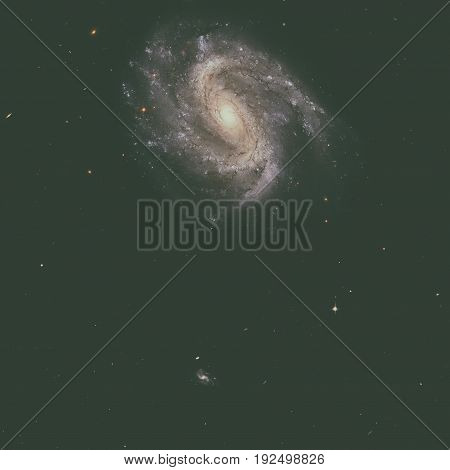 NGC 201 is a barred spiral galaxy similar to our own galaxy, the Milky Way. Located in the constellation of Cetus. Retouched image. Elements of this image furnished by NASA.