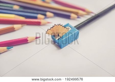 Color Pencil With Sharpening Shavings On White Background,warm Tone