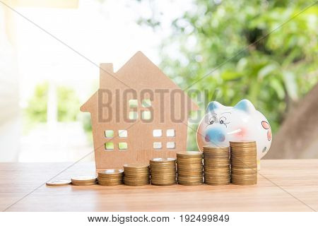 Stack Coins And House Wood Model
